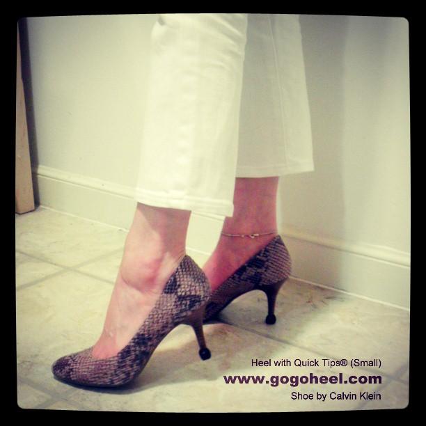 Lady wearing heel with GoGo Heel Cap