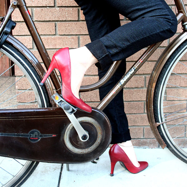 QUICK TIPS Small Caps on red high heels-bike