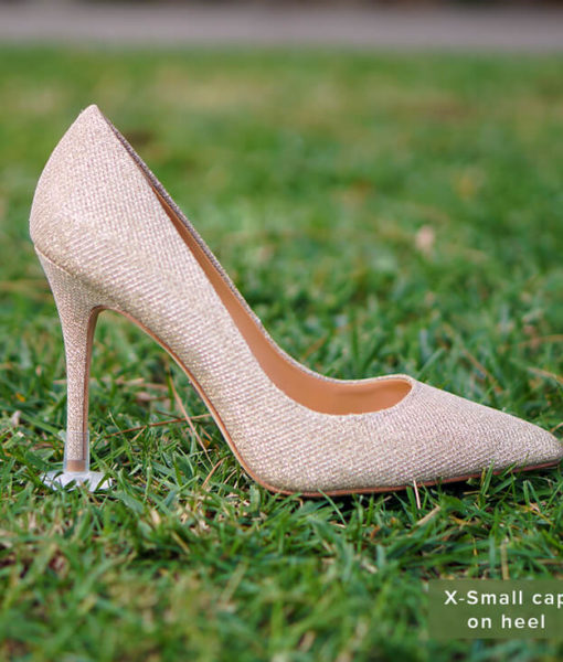 STOPPERS heel protector on gold heels on grass