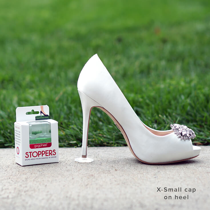STOPPERS Heel Protector on white wedding high heels on grass